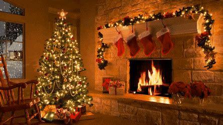 christmas scene christmas fireplace christmas tree snowfall gif gfycat