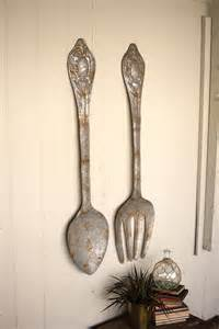 large rustic metal fork and spoon