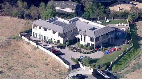search chris brown s house following 911 call from