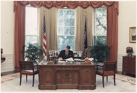 presidential desk in oval office file photograph of president reagan working at his desk in