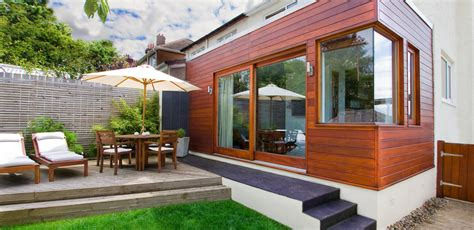 designing a house extension design and build of contemporary ceder clad extension nest home improvement and