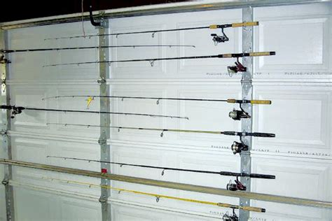 fishing rod storage on garage door uses u bolts to hold