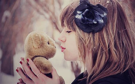 cute girl in love hd wallpaper love wallpapers mood girl kiss bear toy flower snow winter hd love