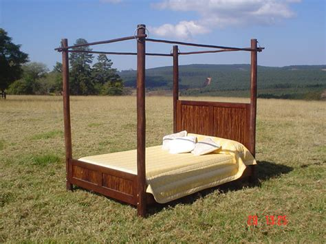 bed with poles jungle furniture beds loungers