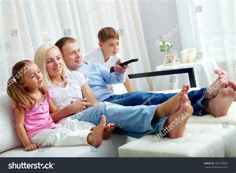 couch watch tv portrait happy family two children sitting stock photo