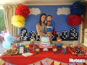 Superman themed birthday party superman cake huggies birthday