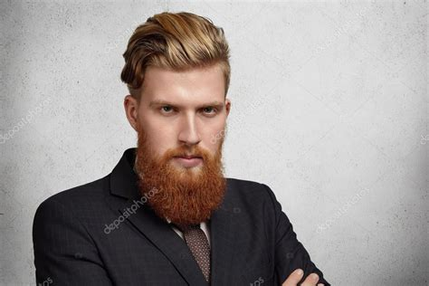 standard businessmans haircut headshot of good looking young corporate worker with
