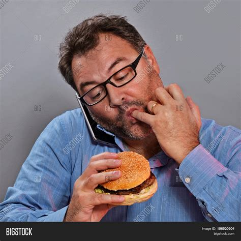 Eat A Burger Save A Price Tag by On Phone While Burger Image Photo Bigstock