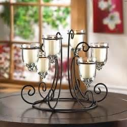 iron candelabra centerpieces wrought iron candle display black 6 glass cups table