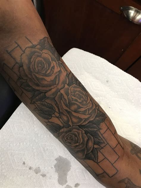 brick tattoo 3 black roses with brick wall background