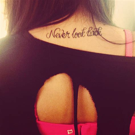 never look back tattoo written on back ink heart