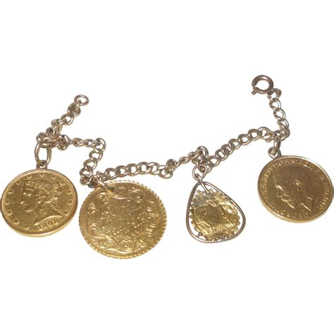 vintage 14k yellow gold charm bracelet with gold charms
