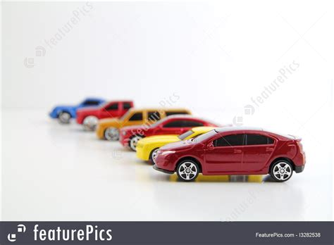 Electric Car Company Stock Row Of Cars With Electric Car In Focus Picture