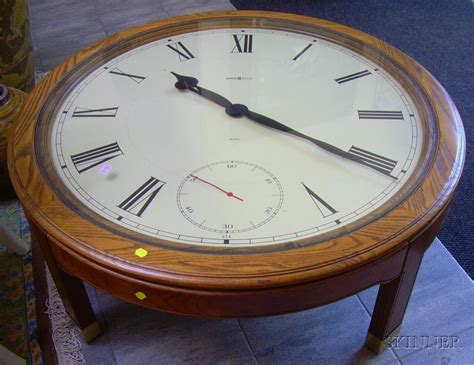 oak howard miller clock coffee table sale number