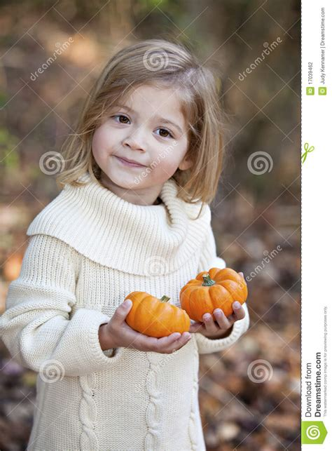 little girls little pics little girl with tiny pumpkins stock photography image