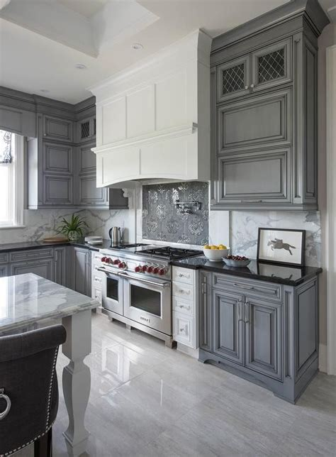Grey Kitchen Cabinets With Black Countertops by White And Gray Kitchen Features Gray Wash Cabinets Paired