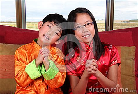 new year greeting gesture two offering new year greetings stock photo