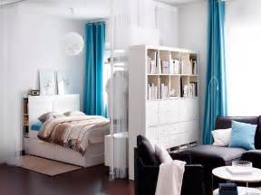 studio apartment size white bookcase dividing space studio apartment room