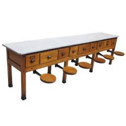pull out table early 20th century institutional work table with pull out seats at 1stdibs