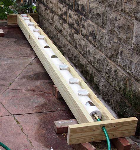 Self Water Planter rain gutter grow system as a raised bed tomatoville