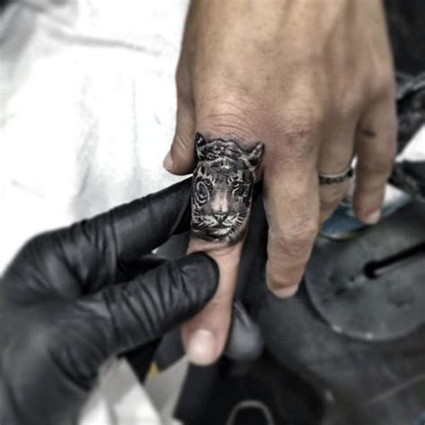 ring finger tattoo designs for men 75 finger tattoos for manly design ideas