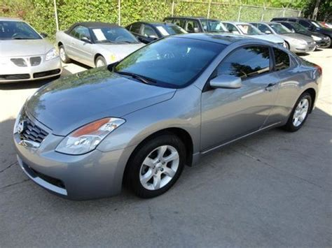 find   nissan altima  coupe  miles