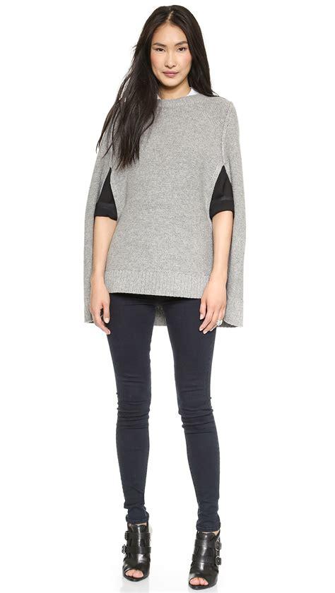 minimal look in grey knit symphony of silk dkny pure wool knit cape in gray lyst