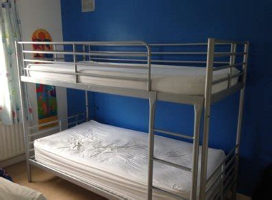 ikea svarta silver bunk bed frame 2 mattresses for sale in