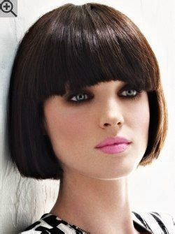 Classic short bob with beveling in the cutting line and soft styling. The bangs are lightly