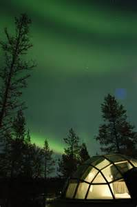 the northern lights from glass igloos at hotel