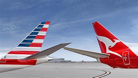 emirates qantas status credits qantas cuts points status credits on american airlines
