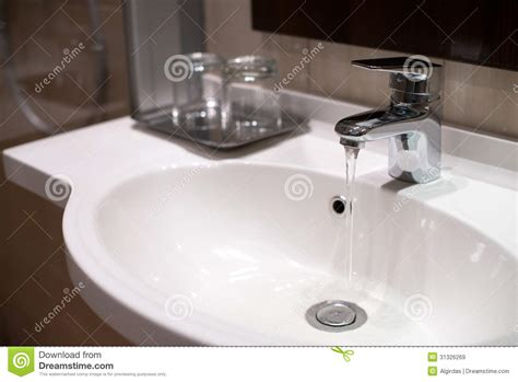 Kitchen Faucet Drips by Water Running In Sink From Tap Royalty Free Stock Images
