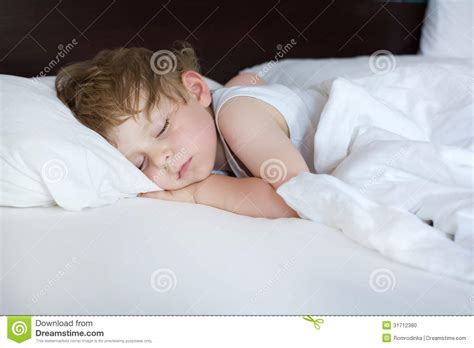 cute teenager girls sleeping stock photos and images little sweet toddler boy sleeping in his bed stock photo