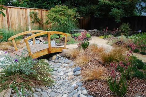 yard bridges fill in the lacking beauty in your garden with a bridge