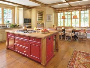 pale yellow country kitchen with large red island hgtv