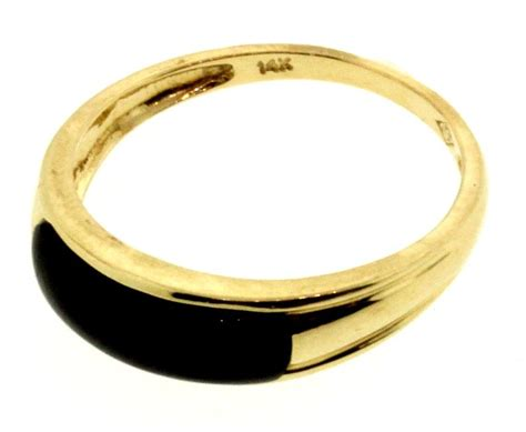 2 4 gram 14kt yellow gold ring with black property