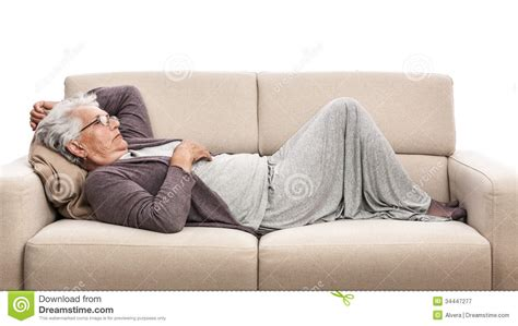 laying on my couch old woman laying on the sofa royalty free stock