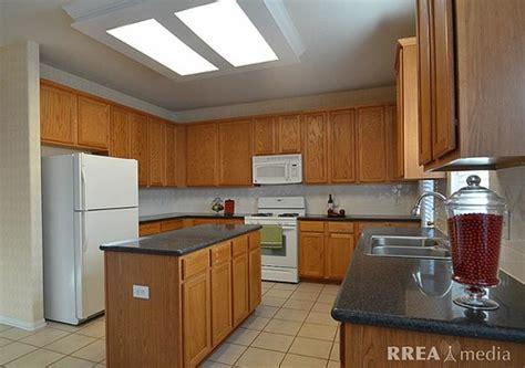Help update 1990s oak cabinets in a kitchen w/ dark quartz