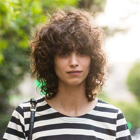 curly hairstyles with fringe for long hair tips for great bangs with curly hair allure