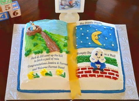 An Adorable Book Cake Designed For A Storybook Baby Shower Nursery Rhymes Baby Shower Decorations