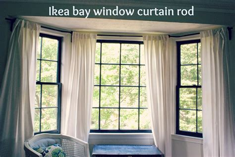 bay window with curtains between blue and yellow bay window curtain rod