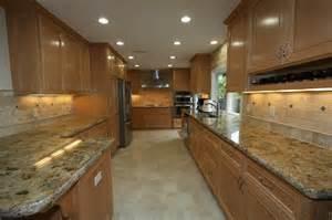 Green Kitchen Stories Blog - maple cabinets travertine backsplash granite counter and ceramic tile flooring yelp