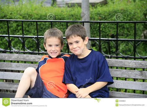 bench boys boy on a bench in the park stock images image 2599884