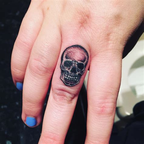 what does a skull tattoo mean skull on finger designs ideas and meaning