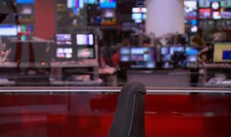 Express And News Desk news broadcast begins with empty chair as presenter is in front of wrong uk news