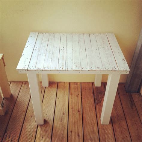 recycled pallets and 2 ikea lacks made an awesome rustic my pallet balcony table though we used an old ikea bed