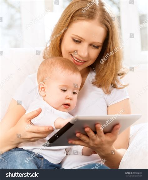 the last mama on the couch play mother baby looking play read tablet stock photo 151632473