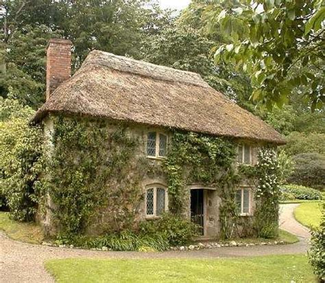 Cottage Up by This House Leaded Windows Thatched Roof Vines Via