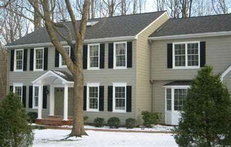 monterey taupe hardi plank front black shutters and white trim beige exterior