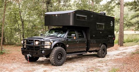 rugged  road camper sports  surprisingly fancy interior curbed